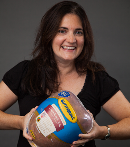 Image of a woman holding a turkey